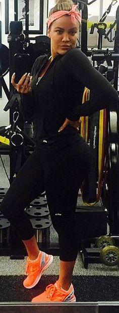 Who made  Khloe Kardashian's orange sneakers, black capri pants, and sweatshirt?