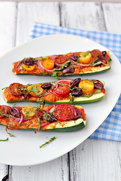 Zucchini Pizza Boats - Natural Vitality Living. When summer comes and I have a garden full of cherry tomatoes and zucchini.. These are happening. :)