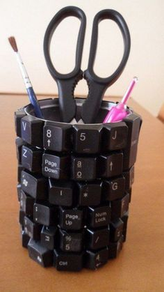 Upcycled holder with keyboards and tin can. Tin cans are not just for stacking up in your cabinet, tossing in the trash or sending to the recycle bin. Combine those with a rope, paints, craft papers and a generous helping of crazy imagination, and you will have a cool creation on your hands.