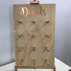 These stunning Mini Donut Walls are the perfect addition to any party or event! These Mini Donut Walls hold up to 24 donuts (2 donuts per peg) and are sold in DIY form, so we supply the board with precut holes and 12 pegs which you just gently hammer into place! The Donut Walls