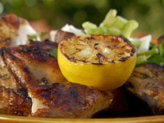 Butterflied Chicken with Thyme, Lemon and Garlic recipe from Bobby Flay via Food Network