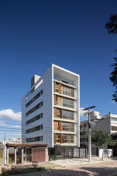Built by  Arquitetura Nacional in Porto Alegre, Brazil with date 2013. Images by Marcelo Donadussi. Praça Municipal 47 is an example of the ongoing transformation of the project's surrounding location: mid-rise reside...