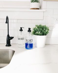 Love, love, love this clean, modern font in this kitchen! Do you need to upgrade your kitchen counter? These bottles are so easy to use and make your entire kitchen look more organized!#kitchenaccessories #farmhousefresh