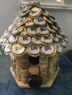 Wine Cork and Beer Cap Bird House. House roof made of flattened Miller Lite Beer Caps. Wine Cork themed house