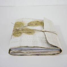 """Eco printed and hand stitched double cloth cover, eco printed paper and mylar, interspersed with photographic prints, sewn pages and sheets of handmade paper. - one of a kind  , 7"""" x 5"""",  64 pages 2014 - by Lotta Helleberg"""