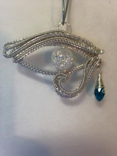 wire wrapped eye of Horus pendant handmade eye of by FreeStyles