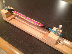 I took ideas from several home-built paracord jigs I've seen online and built this one for my daughter. Turned out pretty well! Use it to build yours!
