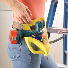 Here's a great way to carry your cordless drill as you work. Cut the bottom and part of one side from a 2-qt. bottle of Pledge Floor Cleaner.