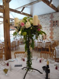 wrought iron candelabra, decorated for a pink and white early summer wedding at Upwaltham Barns by Spriggs Florist.  Call us on 01798 344133 to discuss the flowers for your wedding.