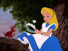 Alice gets through a dull history lesson by fashioning a daisy chain for her cat Dinah. -- Alice in Wonderland: 60th Anniversary Edition Blu-ray + DVD Review