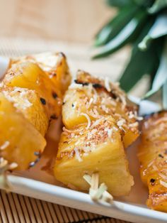 """Coconut-Glazed Pineapple Ingredients:   1 12-ounce can coconut milk 1/2 cup brown sugar 1 large pineapple, sliced into 1""""-thick rounds 1 teaspoon cinnamon 1/4 cup toasted coconut flakes or fresh chopped mint (optional)"""