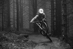 Popping out of this small berm into a power wheelie into the next fast and wet section.