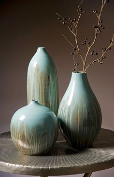 Abydos Large Vase - The beautiful reactive glaze used on this ceramic vase serves to accentuate its fluid lines and minimalist form. For a coordinated look purchase all three sizes. Enquire for price.