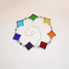 A Chakra sun catcher...love the colors & combo of silver and glass beads all lined up on a chain!