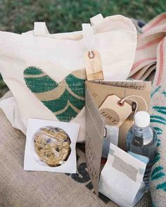 These muslin bags were embellished with sewn hearts cut from coffee bean sacks. They were stuffed with water, cookies from a local bakery, and the groom's favorite snack, Chex Mix. Trail mix bought in bulk was repackaged into little white paper baggies and sealed with tags.