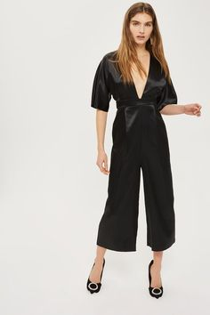 This chic jumpsuit boasts a plunge neckline and modern detailing. In a rich black satin, we're styling it with on-trend heels and statement earrings for a perfect party look.<br /><br /><b>Model's height is and she wears a UK size Satin Jumpsuit, Black Jumpsuit, Playsuits, Jumpsuits, Party Looks, Occasion Wear, Signature Style, Black Satin, Elegant Dresses