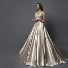 Super romantic gold wedding dress with lace top by Eva Lendel