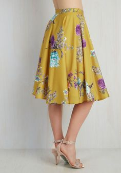 Shape, line, and form unfold fashionably as you drift past delicate flower displays in this smooth, mustard A-line skirt - a ModCloth exclusive! The print you wear is an array of turquoise, violet, and citrus flowers whose stems and leaves are emphasized like the perfected works you pass. Your virtuosity for this art form is truly worth treasuring, as is this high-waisted midi skirt!