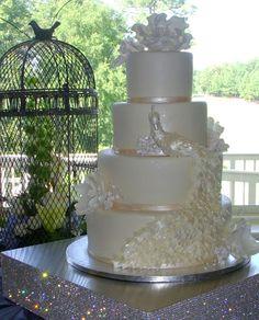 http://ambrosiacakecreations.com/wp-content/uploads/2013/01/peacock-wedding-cake.jpg