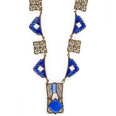 Classic Art Deco geometric style necklace with links of brass filigree and enameled brass. Pendant is brass filigree with two bezel set blue glass stones. Pendant measures 1-5/16 x 11-16 inches.  Necklace circumference is 15 inches.  Brass spring clasp. Good vintage condition with slight enamel loss on one link. Brass spring clasp. Czechoslovakia.  1920's.