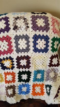 A crocheted Granny Squares throw with white background and multi colored granny squares. This is perfect sized throw that can be used in living areas or bedrooms. Approx measurements: Width: 44 Length: 69 I do combine shipping costs if more than one item is purchased.