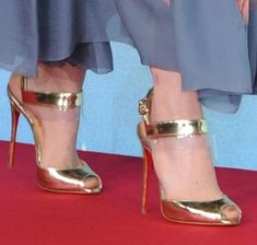 Emma Stone wearing gold Christian Louboutin heels