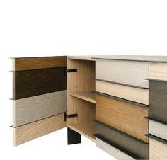 2-door, 4-drawer sideboard, structure in natural oak veneer on particle board. Handles and legs in lacquered steel, in black or sand color. Composition with a ...