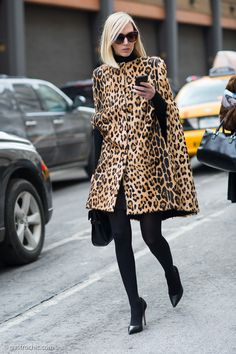 Jane Keltner de Valle wore a great leopard-print cape to the Ralph Lauren show in New York.