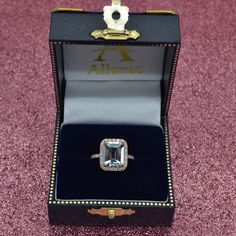 This emerald cut aquamarine engagement ring features a aquamarine surrounded by in diamonds on a rose (pink) gold band. Large Engagement Rings, Engagement Ring Sizes, Diamond Engagement Rings, Aquamarine Rings, Body Jewellery, Imitation Jewelry, Quality Diamonds, Wedding Rings, Wedding Bells