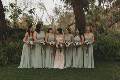 Outdoor Garden Bridal Party Portrait, Bride in Strapless A Line Floral Lace Stella York Wedding Dress, Bridesmaids in Mismatched Sage Green Floor Length Dresses, with Ivory, Blush, and Dark Red Bouquets with Greenery and Long Champagne and Maroon Ribbons | Tampa Bay Wedding Photographer Stacy Paul Photography | Tampa Bay Rustic Wedding Venue Cross Creek Ranch