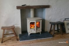 Charnwood Country 6 in Cream Installed By Kernow Fires.   #charnwood #stove #multifuel #woodburner #almond #double #door #fireplace #mantle #faux #wood #hearth #slate #traditional #freestanding #kernowfires #wadebridge #redruth #cornwall