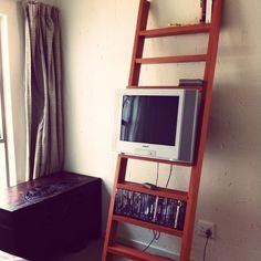 TV/DVD/book bedroom rack from reclaimed veneered chipboard.
