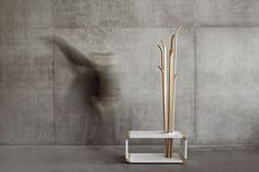 Tilia is a unique freestanding woodenhanger that can be also used as a seating. This object ,,, -UPVISUALLY.COM