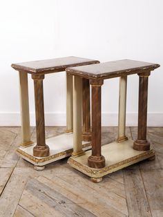 A pair of faux marble painted timber console tables.  All original painted surface, raised on bun feet the front columns supporting a simple timber top.  Damages and losses to some of the gesso decoration to the base.  Circa 1860