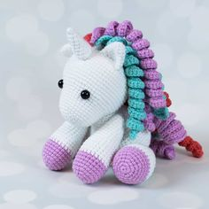 Baby unicorn amigurumi pattern - Amigurumi Today Every girl dreams of her little unicorn pony. Use this free amigurumi pattern to create a magic world of fantasy unicorns for your child! Crochet accessories and experiment with a hairstyle! Crochet Unicorn Pattern Free, Crochet Teddy Bear Pattern, Crochet Animal Patterns, Free Pattern, Pdf Patterns, Mobiles En Crochet, Crochet Mobile, Crochet Patterns Amigurumi, Crochet Dolls
