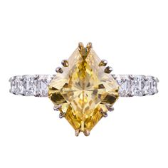 4.22Ct Fancy VIVID Yellow Diamond Ring with Emerald Cut Band