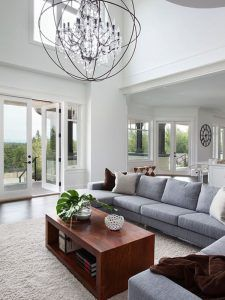 Oversized lighting is a great way to create a focal point in a room. #lighting #focalpoint #livingroom