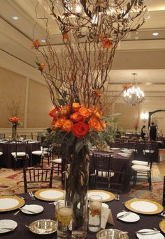 Wedding reception flowers, Wedding centerepieces in orange, elevated centerepieces, Curly willow branches