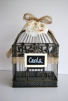 rustic wedding bird cage with burlap and chalkboard sign for wedding cards.