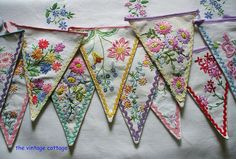 Vintage Cottage. Old embroidered tablecloths become pennants.