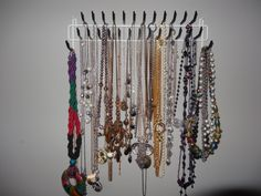 Use a tie rack to hang long necklaces for display. www.youtube.com/beautyblogbs