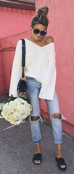 #fall #outfits  women's white long-sleeve shirt and pair of bklue jeans