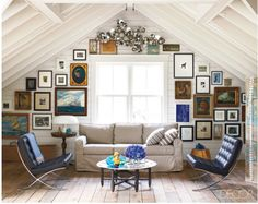 Contemporary meets Colonial.  Love the blues and different gallery wall.