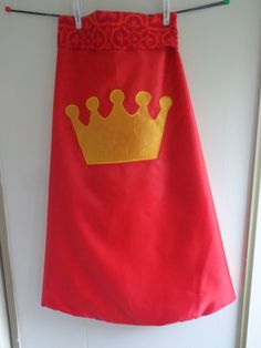 Red dress-up cape, crown emblem. Can be personalized with iron on letter.  $27
