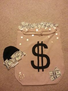 Money bag infant costume Made with fleece felt and money fabric. Cops And Robbers Costume, Bank Robber Costume, Robber Halloween Costume, Newborn Halloween Costumes, Family Costumes, Cool Halloween Costumes, Couple Halloween, Baby Costumes, Fall Halloween