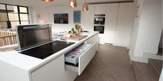 A white matt handleless German kitchen in Queen's Park, London. This is one of our recent projects. Handleless Kitchen, Kitchen Queen, German Kitchen, Kitchen Designs, Kitchens, Park, Modern, Table, Projects