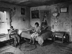 Daily struggles: Farmer's wife Mrs Venus Barnett and son Lincoln in room of their worn farmhouse, Oklahoma, 1942