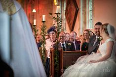 Smiling guests at Lulworth Estate church wedding in Dorset #weddingguests #weddingday #dorsetwedding