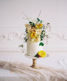 Two tier cake decorated with overflowing yellow flowers, perfect for an intimate spring wedding. Two tier cake decorated with overflowing yellow flowers, perfect for an intimate spring wedding. Trendy Wedding, Floral Wedding, Wedding Flowers, Fall Wedding, Elegant Wedding, Wedding Styles, Rustic Wedding, Wedding Gowns, Wedding Cake Designs