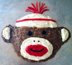I used two 8 inch round German chocolate cakes (froze the cakes for 1/2 hour for easier cutting) and frosted with coconut pecan and vanilla frosting. I used red frosting from a tube for the mouth, black gel icing for the eyes, nose, and mouth, and Twizzlers Pull 'n' Peel licorice for the hat.